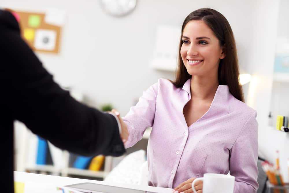 Businesswoman shaking hands in office